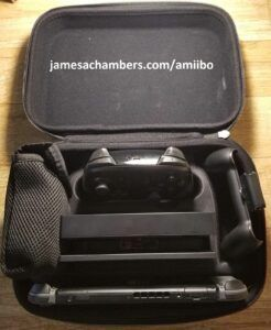 Switch case open showing pro controller, base station, power, etc.